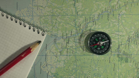 compass maps and notebook Archivo