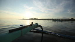 Traveling shot following fishermen boat in the morning Footage