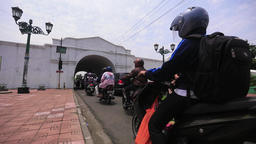 Traffic through the gate in Yogyakarta Stock Video Footage