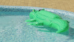 Inflatable Crocodile In A Swimming Pool Footage