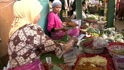 Javanese traditional snack prepared by a middle aged woman Footage