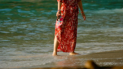 Woman walk on the beach Live Action