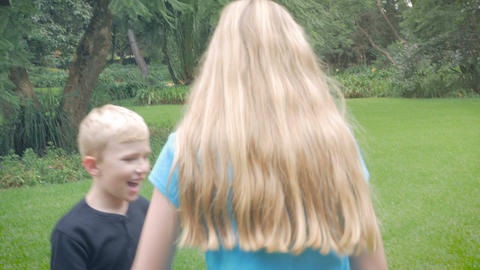 Three siblings or friends play ring around the rosies pocketful of posies and th Footage