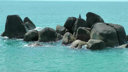 Thailand Ko Samui Island 021 a group of rocks in turquoise water Footage