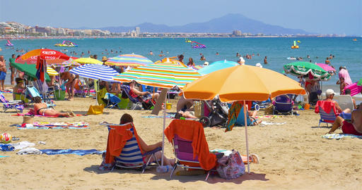 People Having Fun On Summer Holiday In Peniscola Beach At Mediterranean Sea Live Action