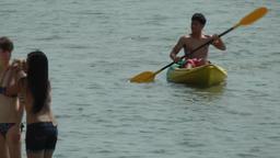 Thailand Ko Samui Island 068 beach scene, girls and a thai guy with a canoe Footage