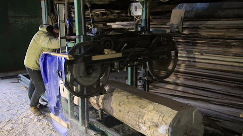 Sawmill. The process of cutting logs into boards Footage