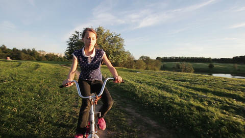 Girl riding bicycle in the countryside Footage