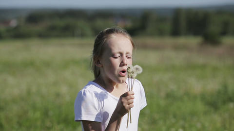Child blowing dandelion Footage