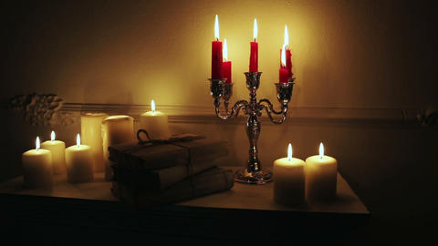 Old vintage books with candles in candlestick Footage