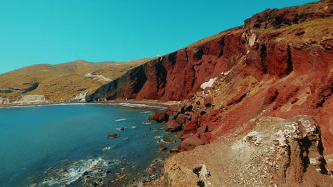 Panning Shot Of Red Volcanic Coast In The Mediterranean stock footage
