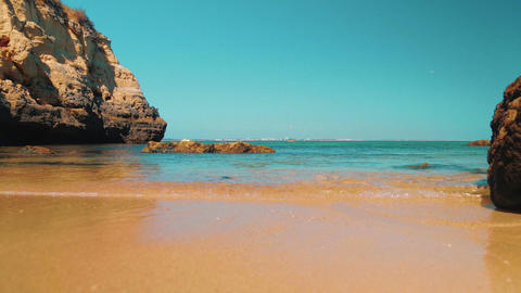 Low Angle Beach Shore Shot in the Algarve, Portugal Footage