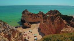 Panoramic Shot of a Rocky Beach with Tourists in the Algarve, Portugal Footage