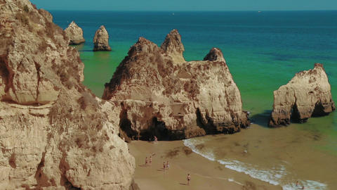 Wide Angle Steady Shot of a Rocky Beach with Tourists in the Algarve, Portugal Footage