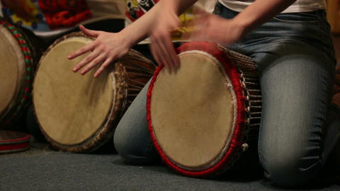 Girls playing on ethnic drums djembe Footage