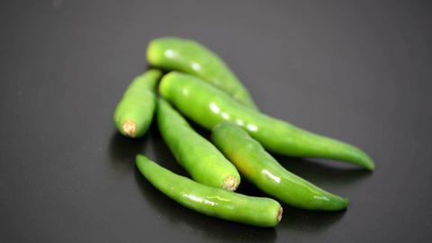 Close up of green chillies, Thai birds eye rotating slowly Footage