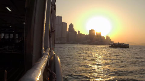Ferry ride in Victoria Harbour in Hong Kong at sunset time Footage