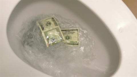 Video of flushing dollars in toilet bowl in real slow motion Live Action
