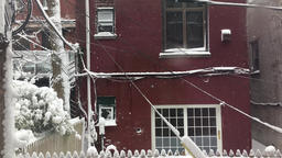 Urban Snowfall and brick building Footage