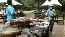 Thailand Pattaya 009 ravindra beach resort, asian waiters prepare buffet Footage
