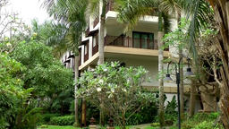 Thailand Pattaya 011 ravindra beach resort hotel balconies between palm trees Footage
