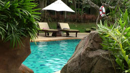 Thailand Pattaya 015 ravindra beach resort, turquoise pool water between stones Footage