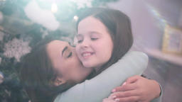 Mother kissing daughter Footage