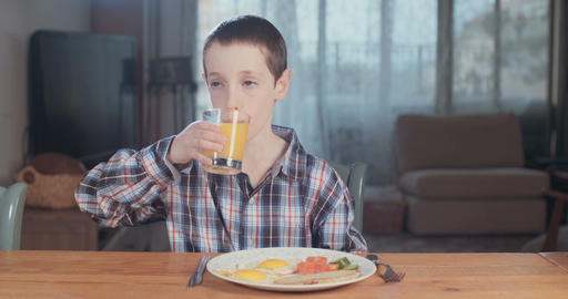 Girl drinking a glass of orange juice Footage