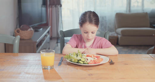 Young girl refuses to eat healthy food and vegetables Live Action