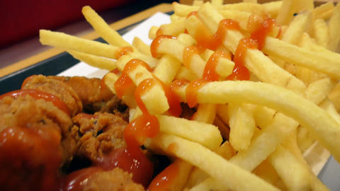 Fast food. Chicken wings and fried fries Footage