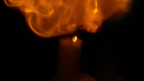 Candle flares up. Magic flame in slow motion ビデオ
