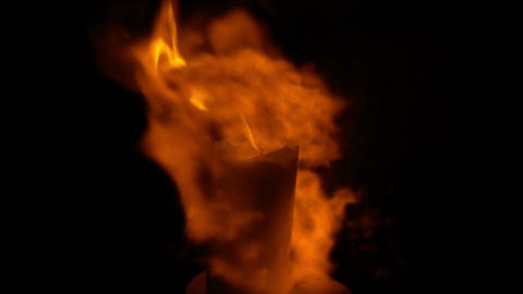 Candle flares up. Magic flame in slow motion Archivo