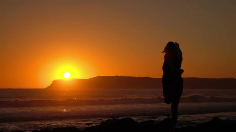 Video of practicing yoga at the sunset in real slow motion Footage