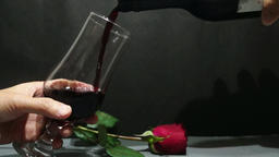 Red Wine into wineglass in slow motion Footage