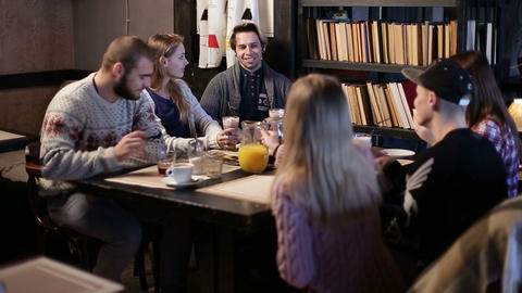 Six hipster student friends communicating in cafe Live Action
