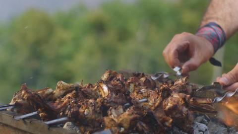 Slow Motion Hands Turn Over Kebabs Skewers in Grill Smoke Footage