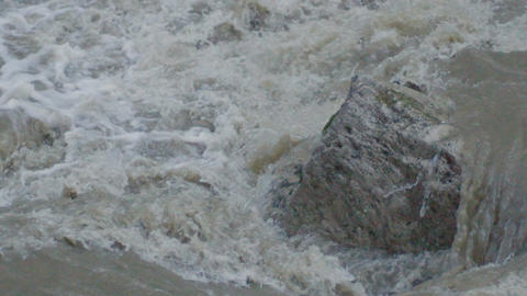 Slow Motion Fast Stormy Mountain River Over Big Rock Footage