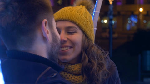 Young couple having fun together outside in winter time Footage