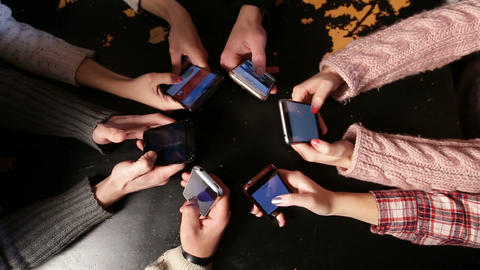 Top view hands circle using smart phones in cafe Live Action