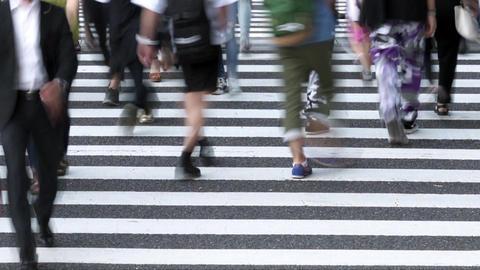 People walking on a pedestrian crossing (time lapse / low speed shutter)