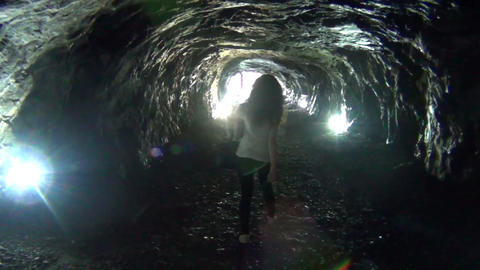 Woman walking out of a tunnel Footage