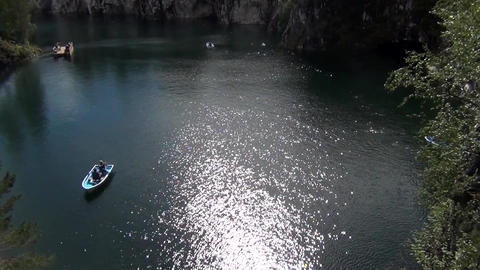 Sunny day on a lake in a family boat Footage