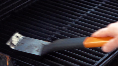 Video of cleaning grill in real slow motion Footage