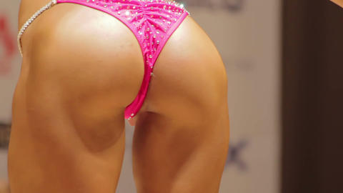 Closeup of sexy female buttocks in glamorous bikini, woman in seductive pose Footage