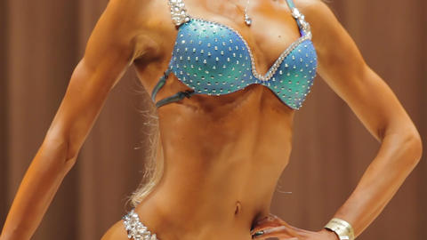 Hot fitness model demonstrating flexible fit body in glamorous sparkling bikini Footage