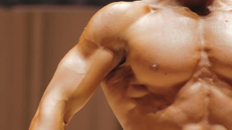 Closeup of strong masculine chest and muscular arms, perfect male body of dreams Live Action
