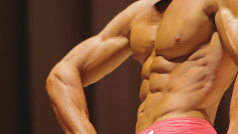 Nervous bodybuilder showing muscular body, waving hands, worried about results Live Action