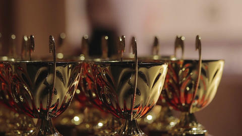 Golden cups sparkling, awards ceremony, victory in contest, competitive spirit Footage