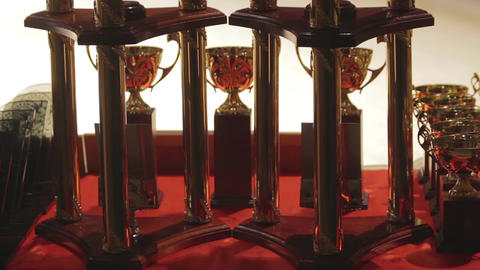 Golden grand prix cups for successful sports contest winners, competitive spirit Footage
