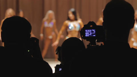 Many photographers using cameras to take pictures at fitness beauty contest Footage